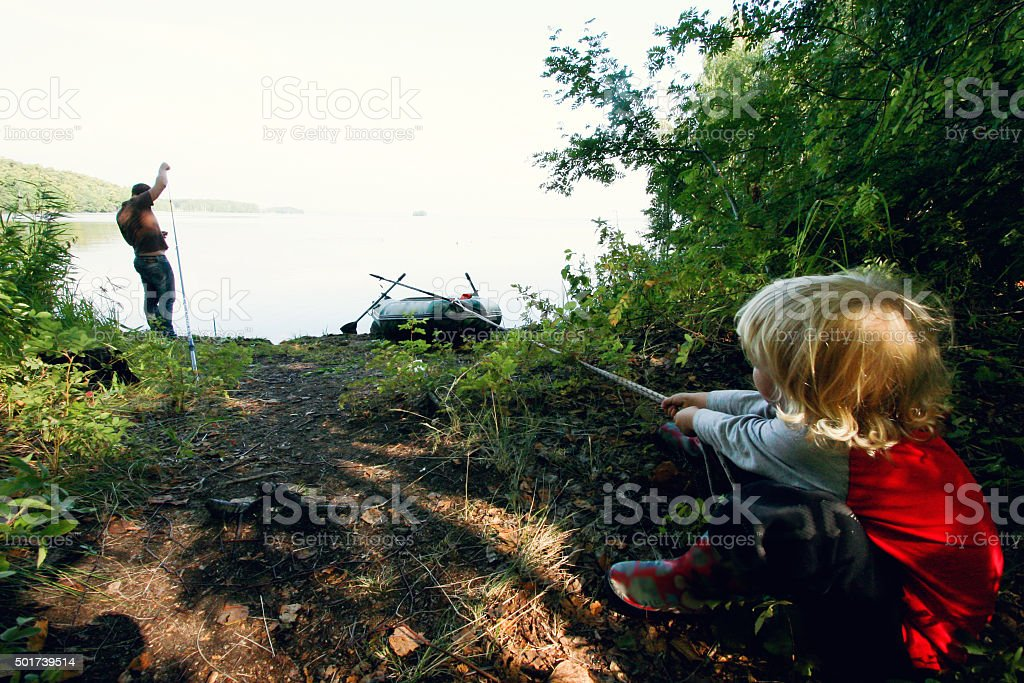 Boy camping on the lake stock photo