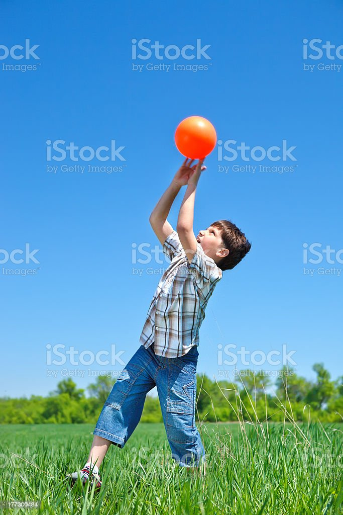 Boy catching a ball stock photo