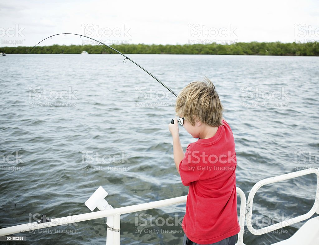 Boy Catching a Fish on Intracoastal Waterway stock photo