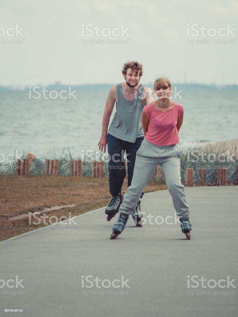 Boy chasing his girlfriend. stock photo