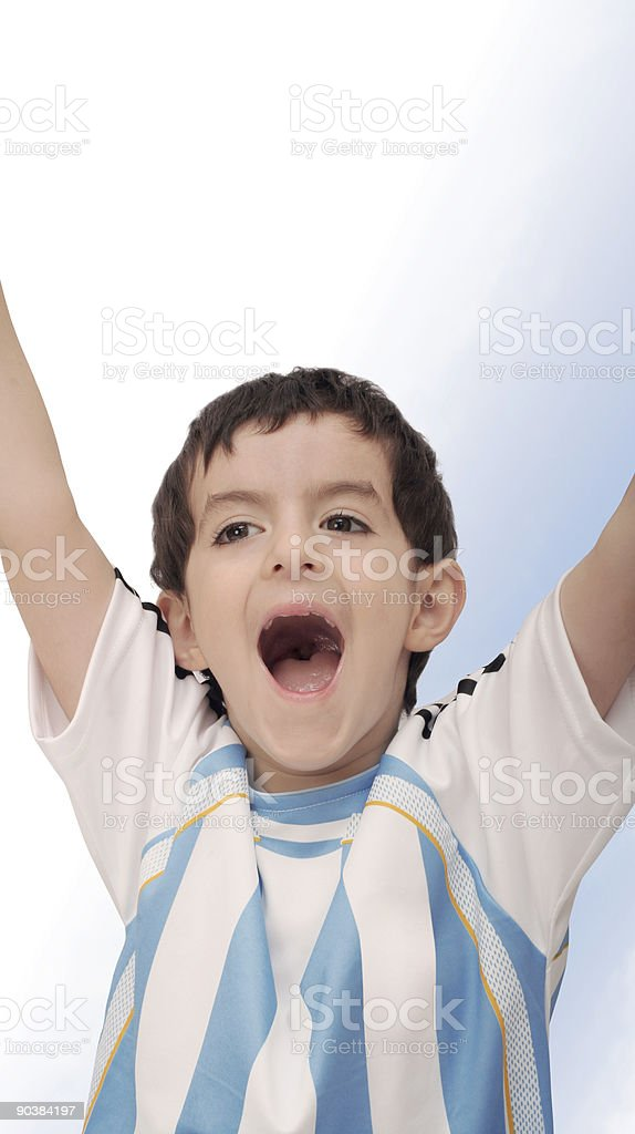 Boy cheering for his team royalty-free stock photo