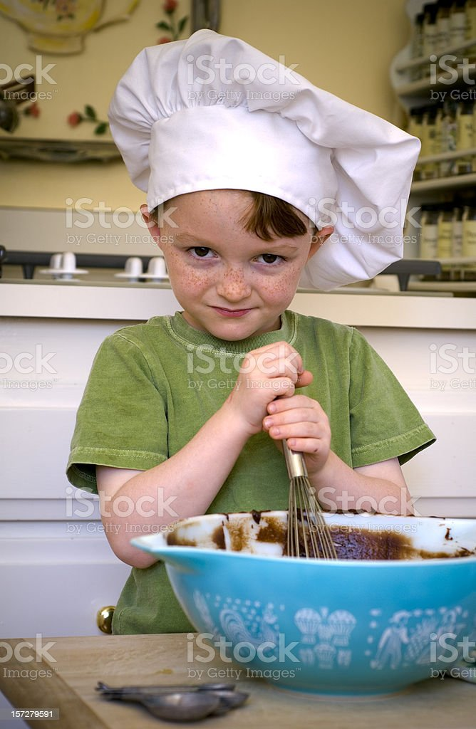 Boy Chef Cooking in Kitchen, Child Baking Cake & Chocolate Brownies royalty-free stock photo