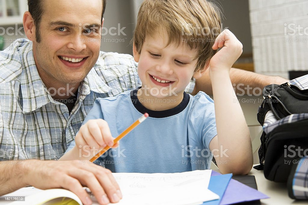 Boy Child Doing Home Work with Father Lifestyle School Education royalty-free stock photo
