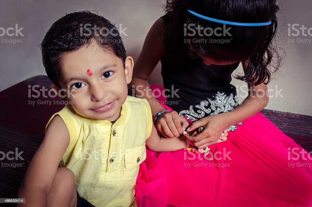 boy child looking at camera excitingly stock photo