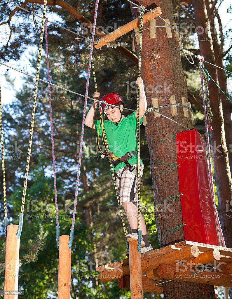 Boy climbing in adventure park royalty-free stock photo