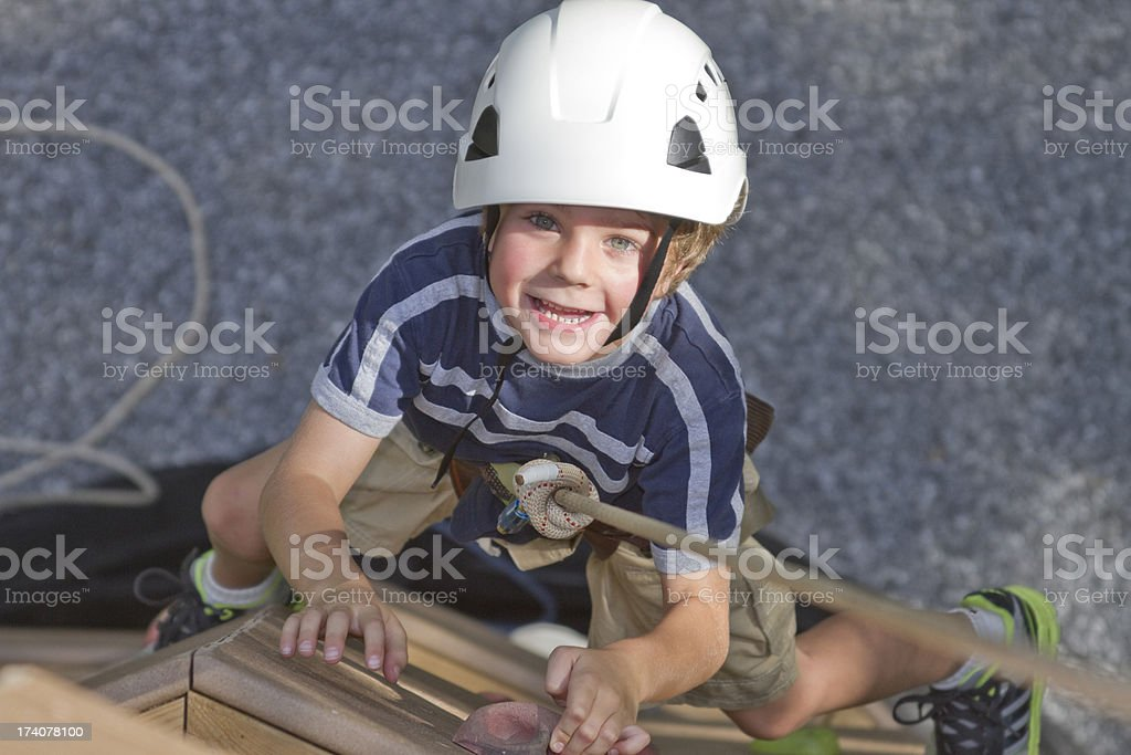 Boy Climbing On Tower / Rock Wall From Above royalty-free stock photo