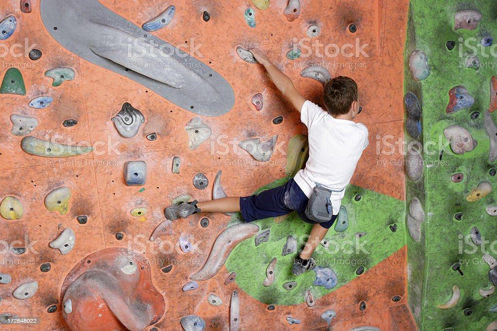 Boy climbing royalty-free stock photo