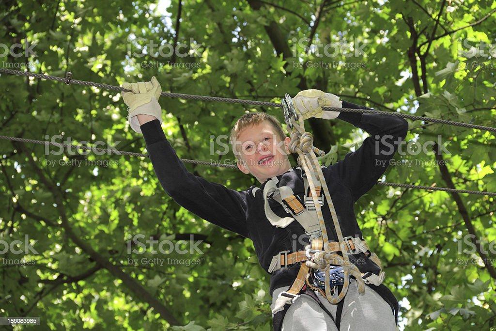 boy climbing stock photo