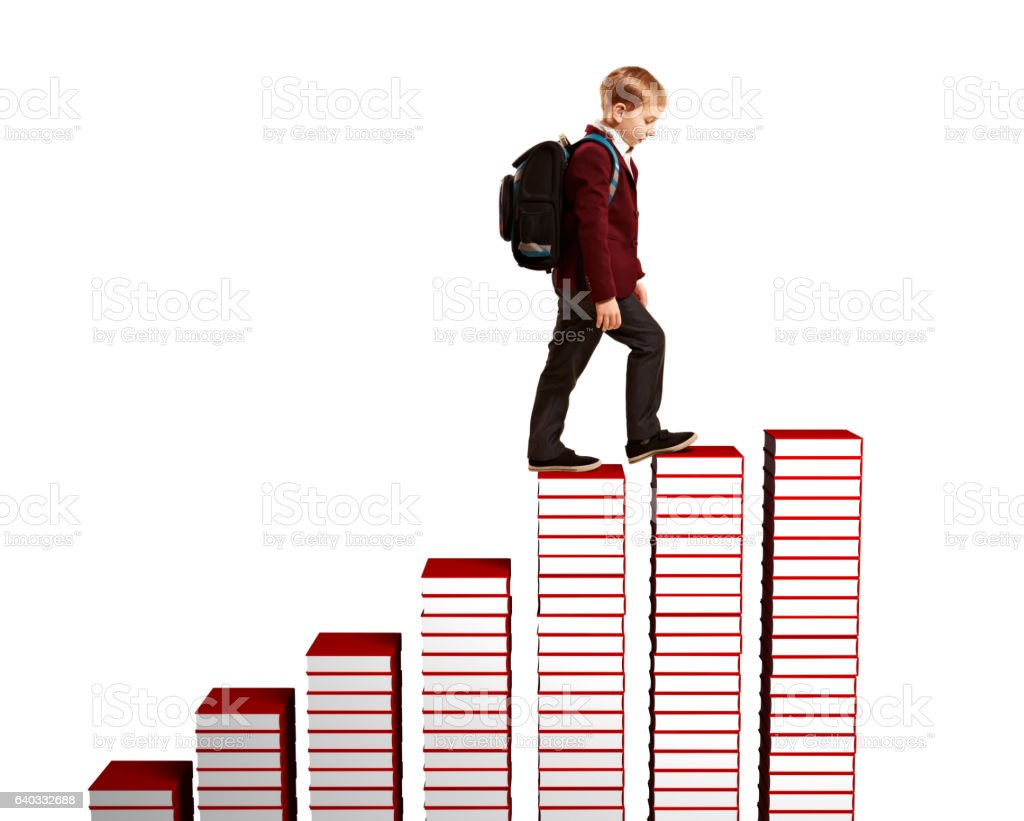 Boy climbing the stairs of books stock photo