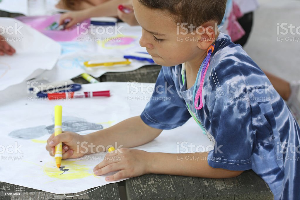 Boy coloring and hand-crafting a self-made kite royalty-free stock photo