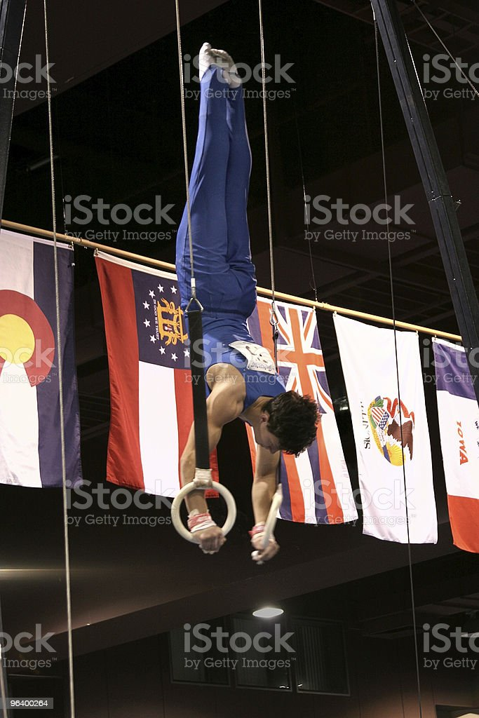 Boy competing on rings royalty-free stock photo