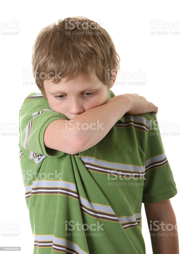 boy coughing into arm royalty-free stock photo