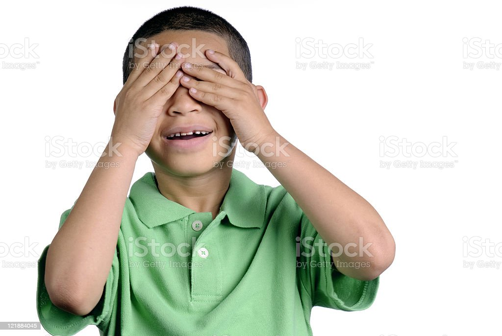Boy Covering His Eyese stock photo
