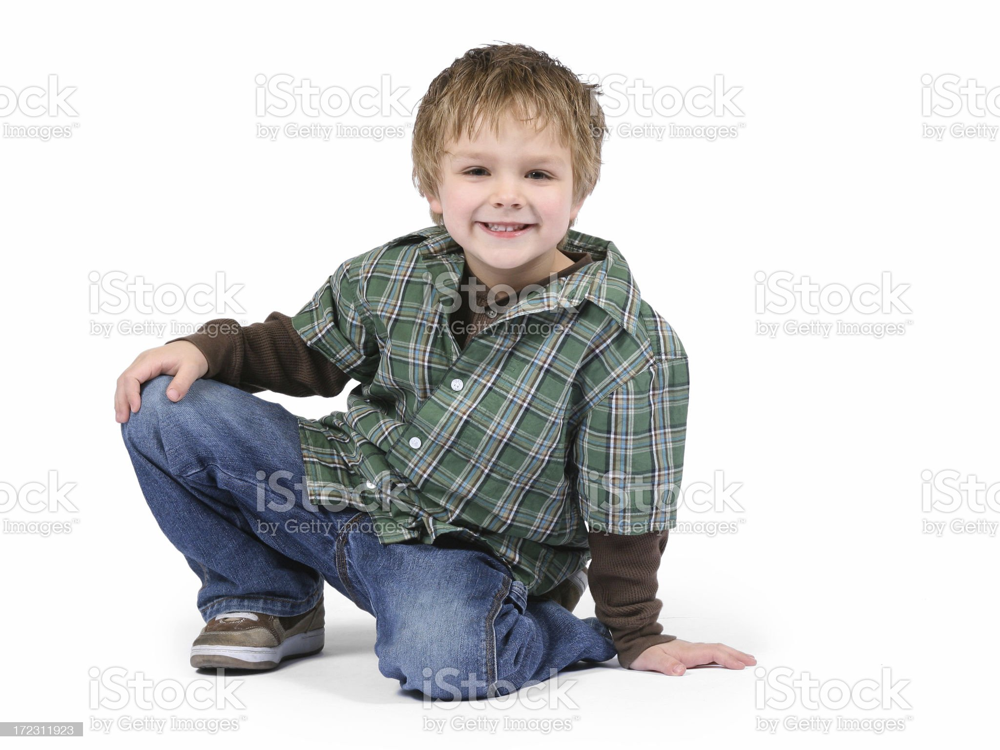 Boy Crouching Down Smiling At The Camera royalty-free stock photo