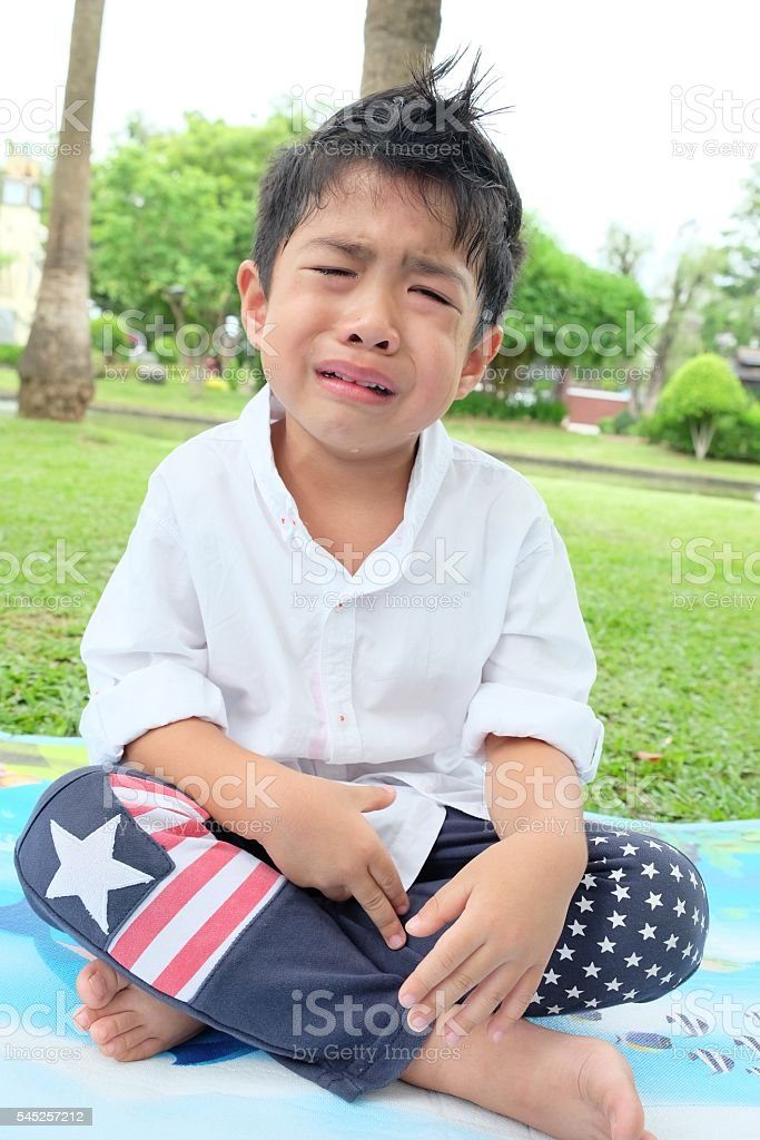 Boy crying stock photo