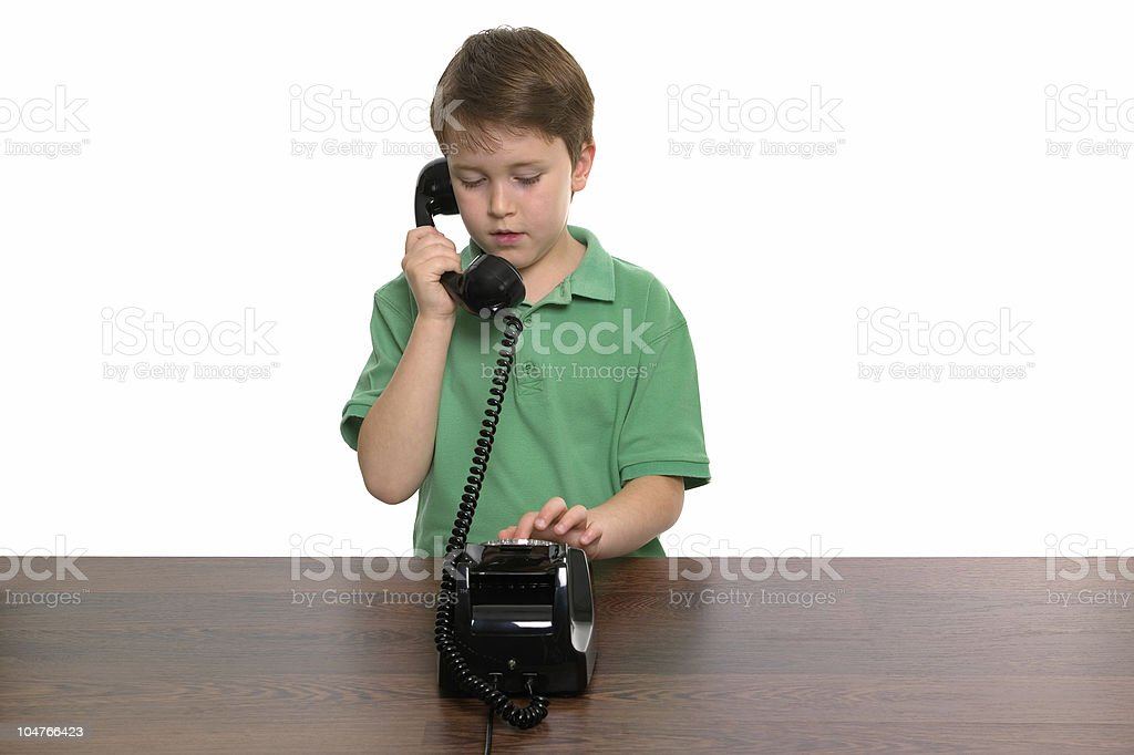 Boy dialling a phone number royalty-free stock photo