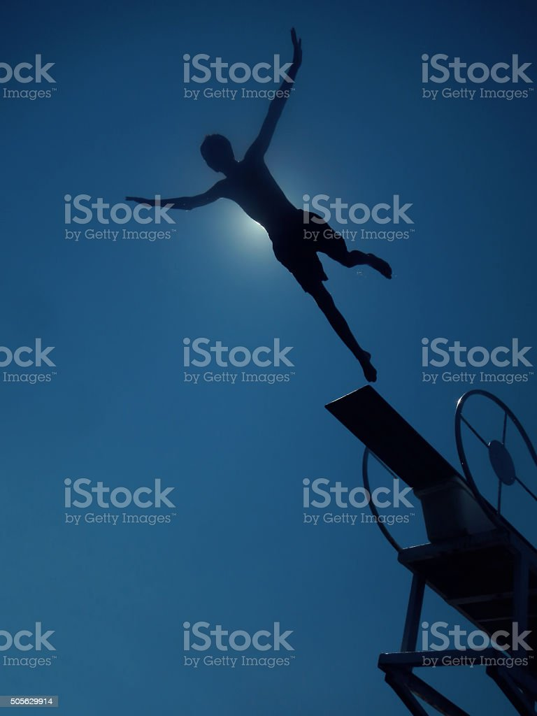 boy diving to sea stock photo