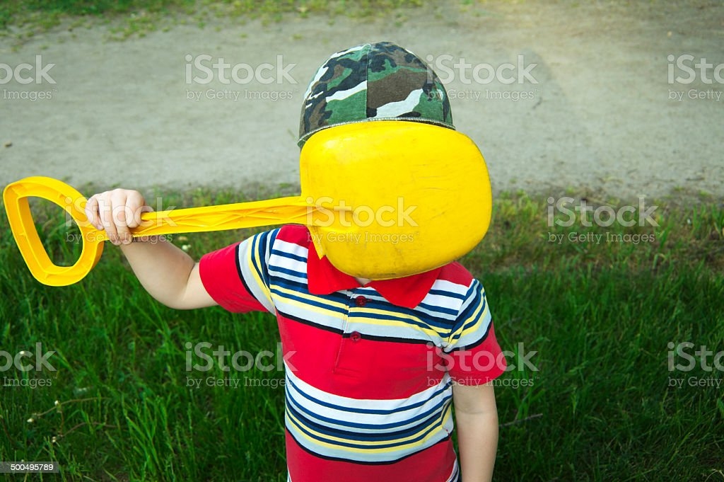 Boy does not want to be photographed stock photo