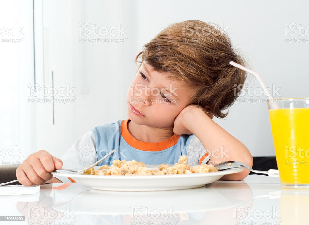 boy does not want to eat stock photo
