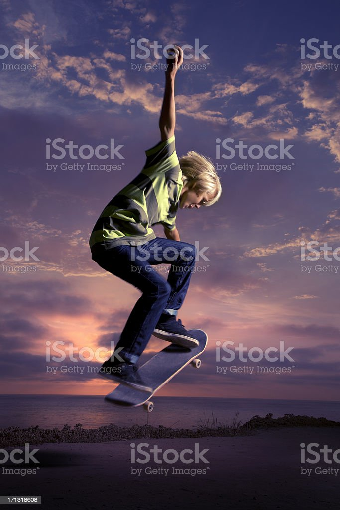 Boy doing a Skateboard Ollie at Sunset stock photo