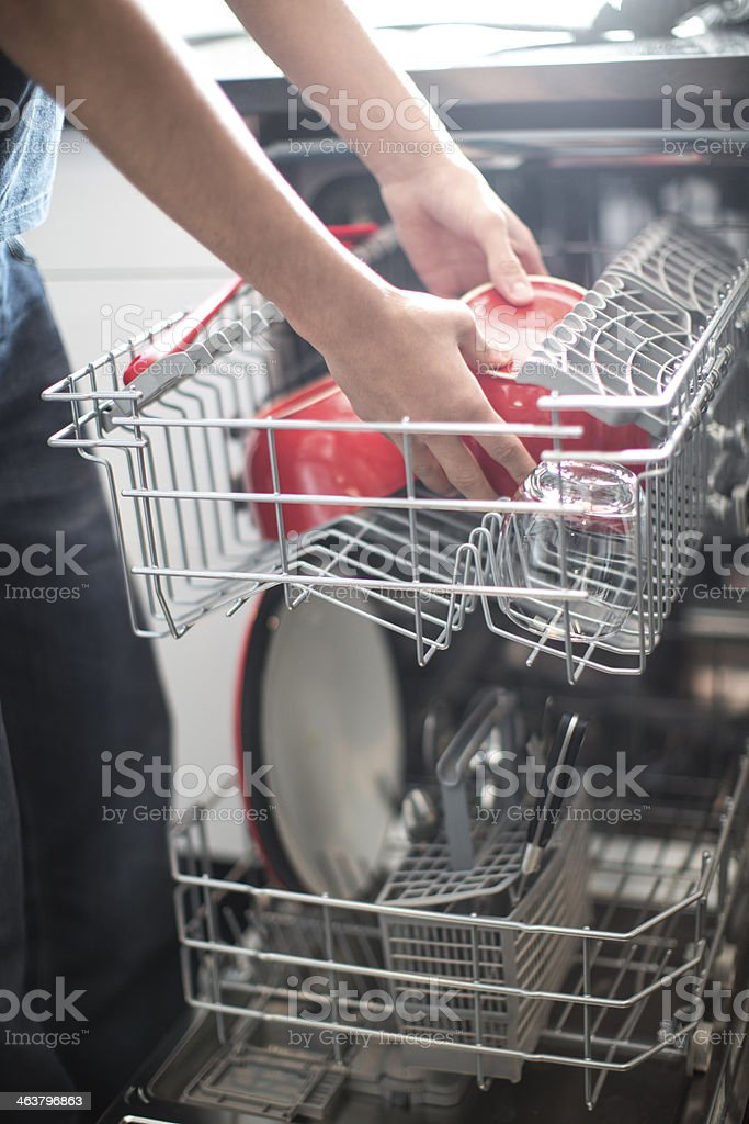 boy doing the dishes stock photo