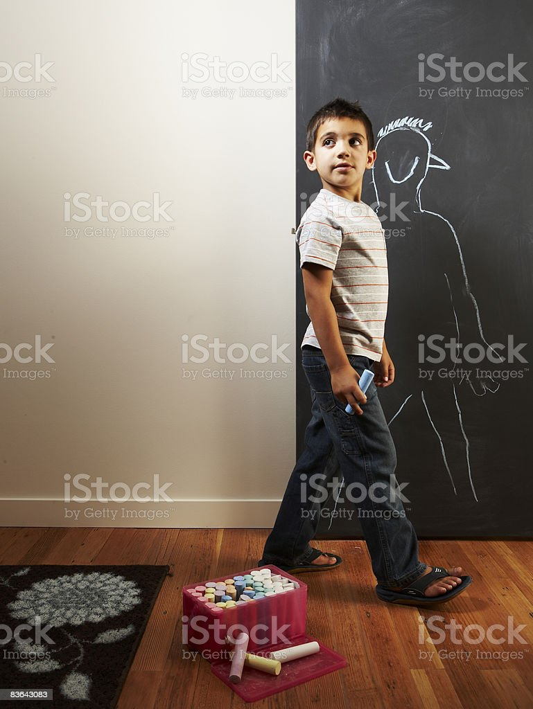 boy drawing with chalk royalty-free stock photo