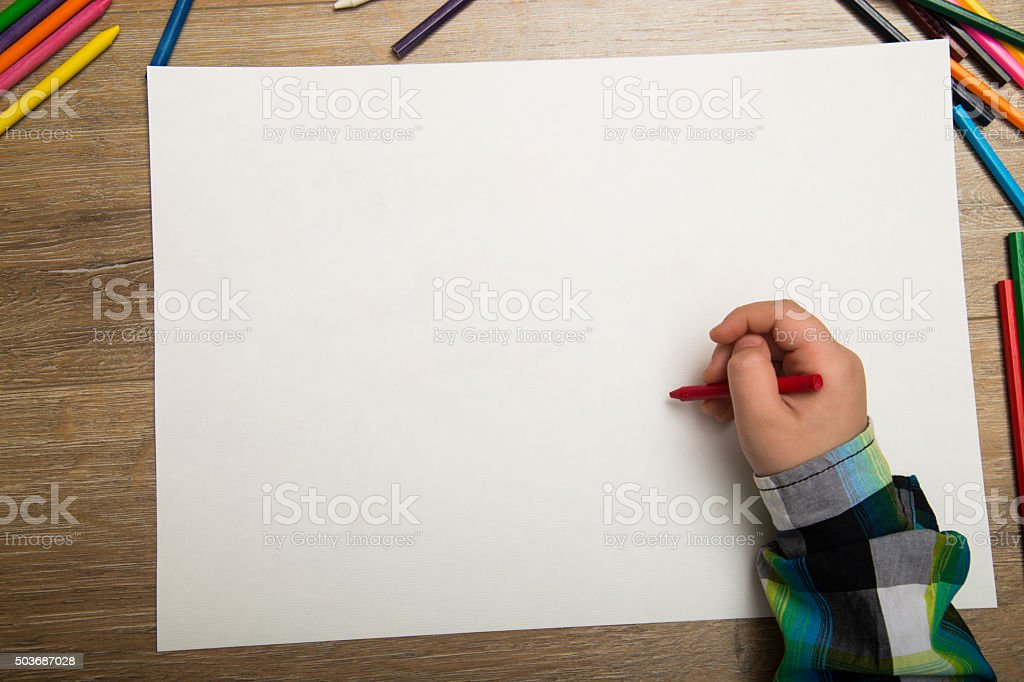boy drawing with water color and crayons stock photo