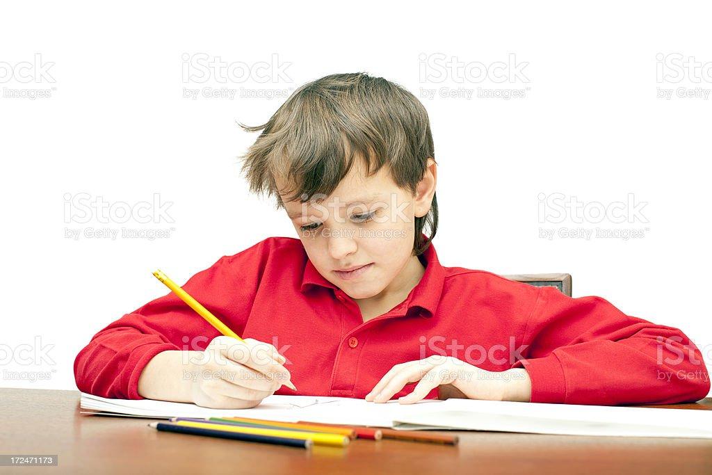 Boy draws a pencil. royalty-free stock photo