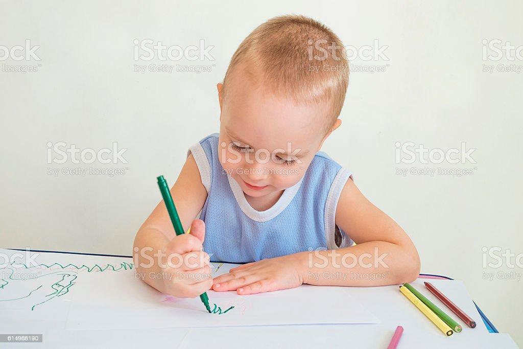 Boy draws stock photo