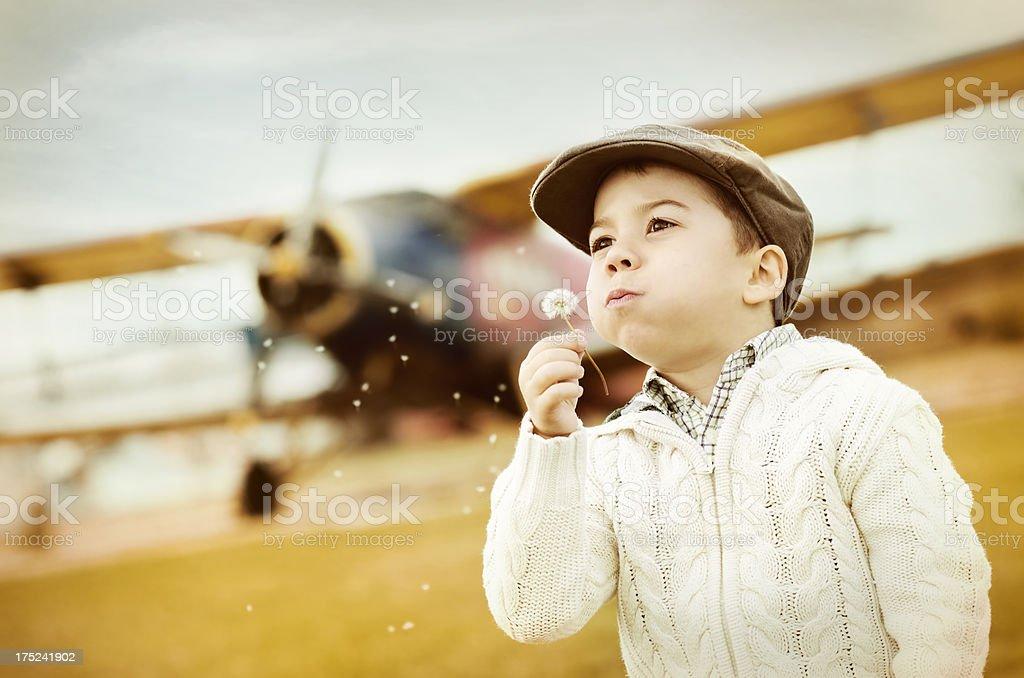 Boy dreams of flying royalty-free stock photo