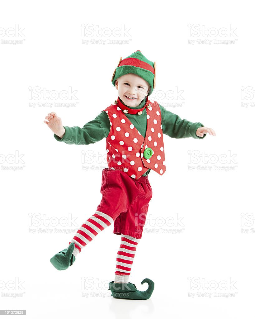 Boy Dressed as Christmas Elf Dances a Happy Jig stock photo