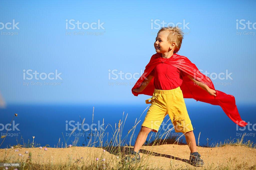 boy dressed as superhero stock photo