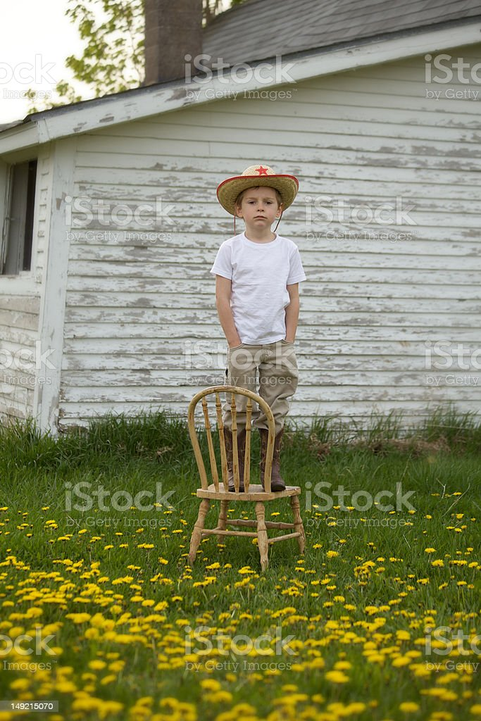 Boy Dressed in his Cowboy Hat royalty-free stock photo