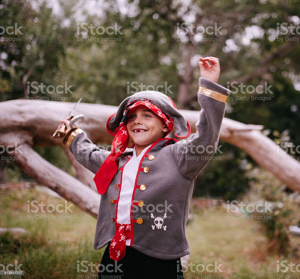Boy dressed up as pirate excited with toothy smile stock photo