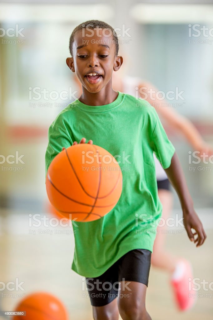 Boy Dribbling a Basketball stock photo
