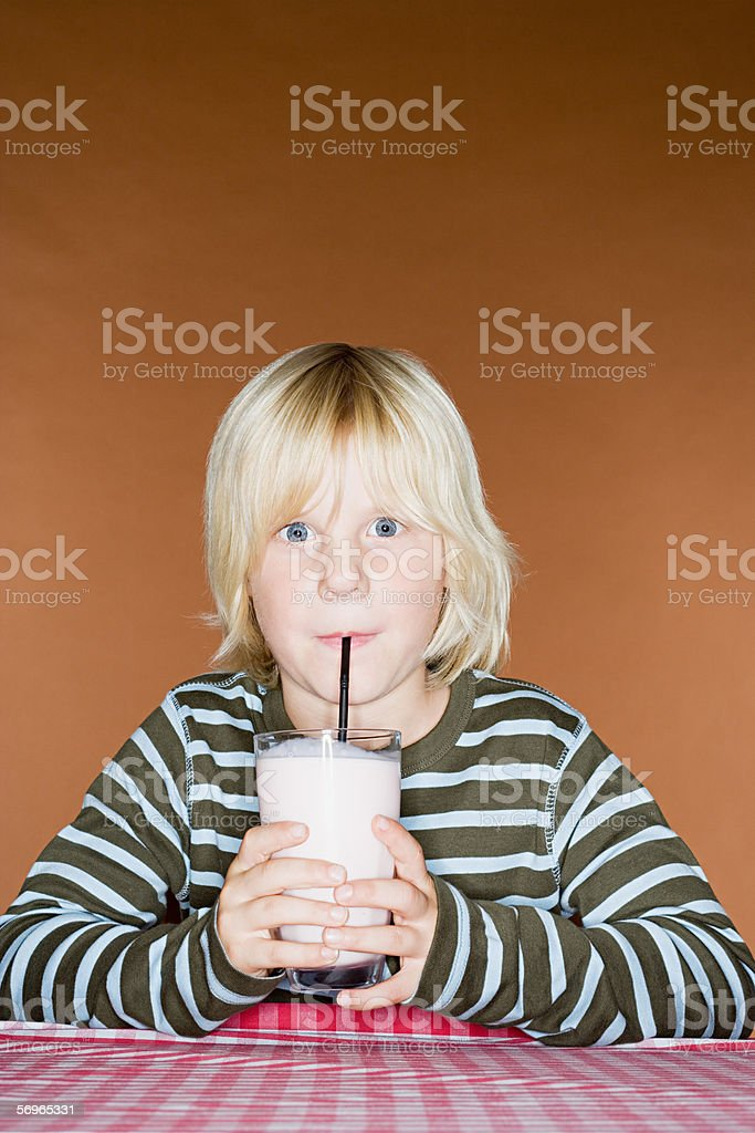 Boy drinking a milkshake royalty-free stock photo