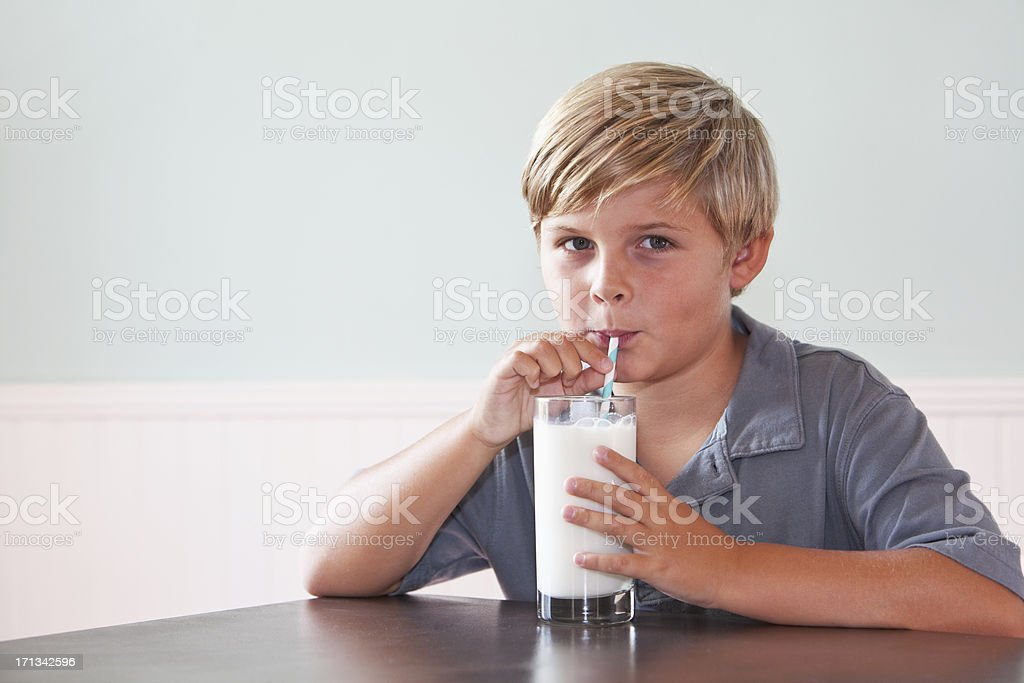Boy drinking glass of milk stock photo