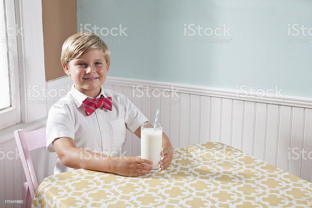 Boy drinking glass of milk royalty-free stock photo