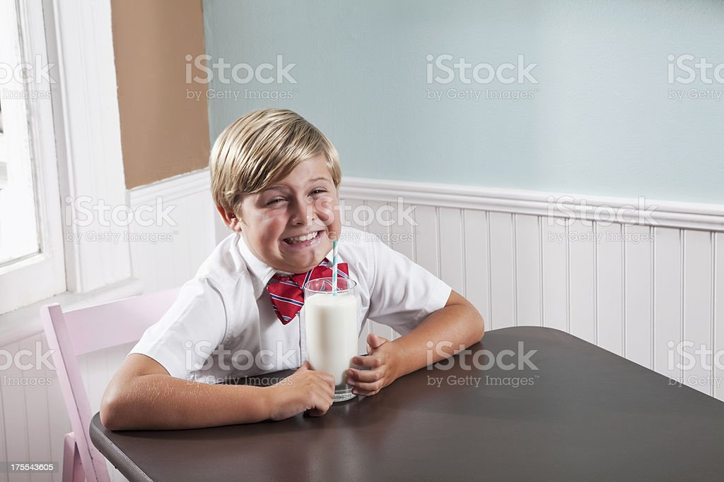 Boy drinking glass of milk royalty-free stock photo