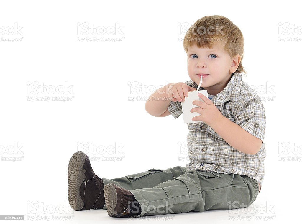 Boy drinking juice stock photo