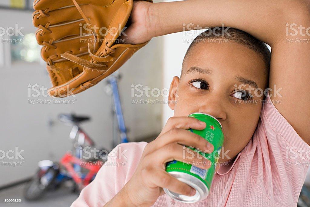 Boy drinking stock photo