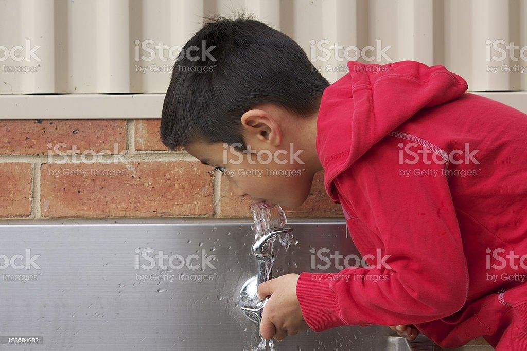 Boy Drinking Water stock photo