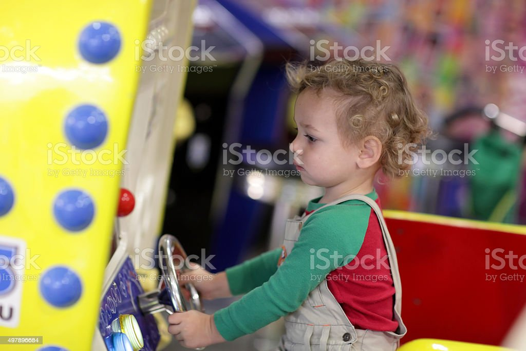 Boy drives a car stock photo
