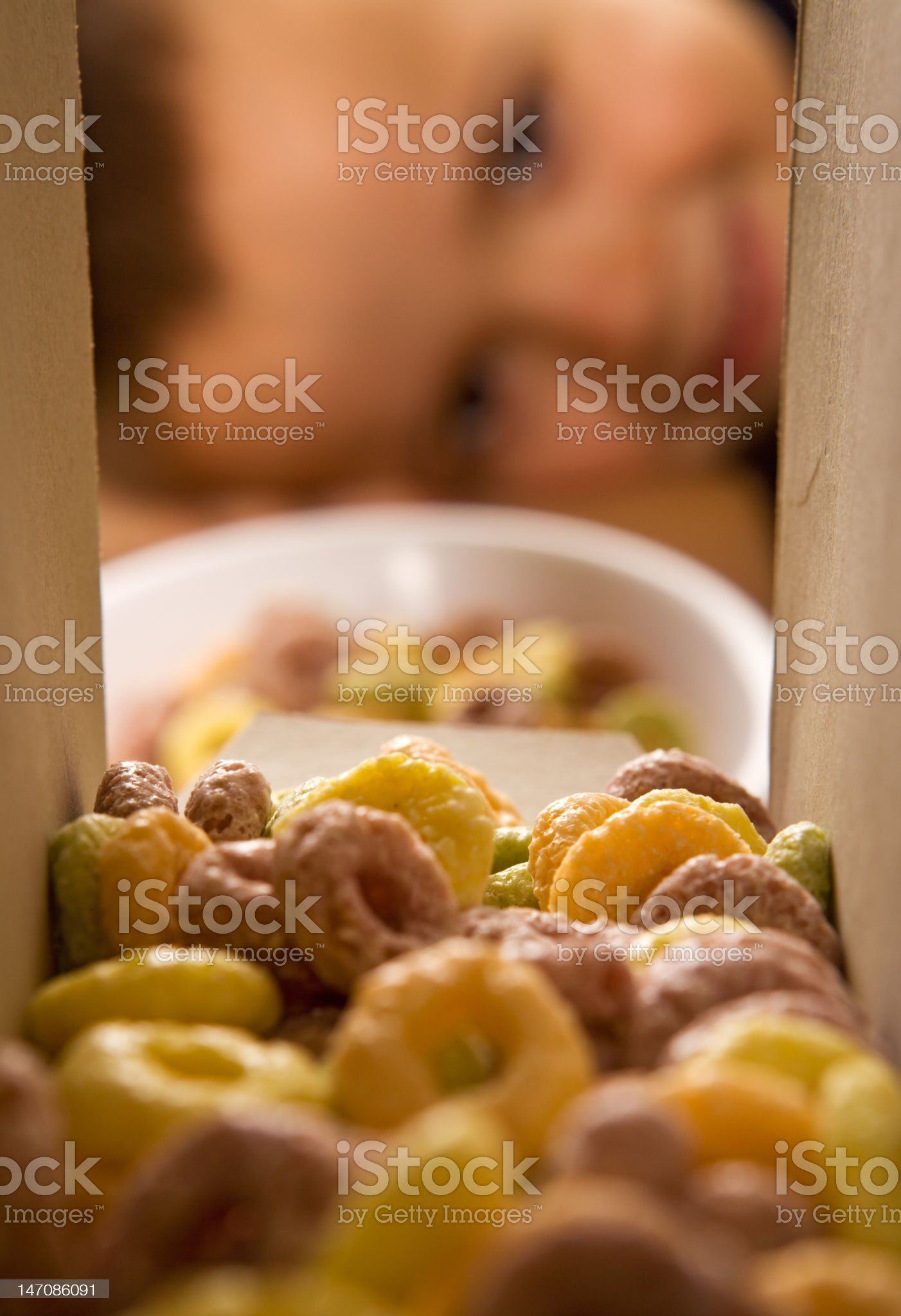 Boy eagerly waiting for the breakfast cereals royalty-free stock photo