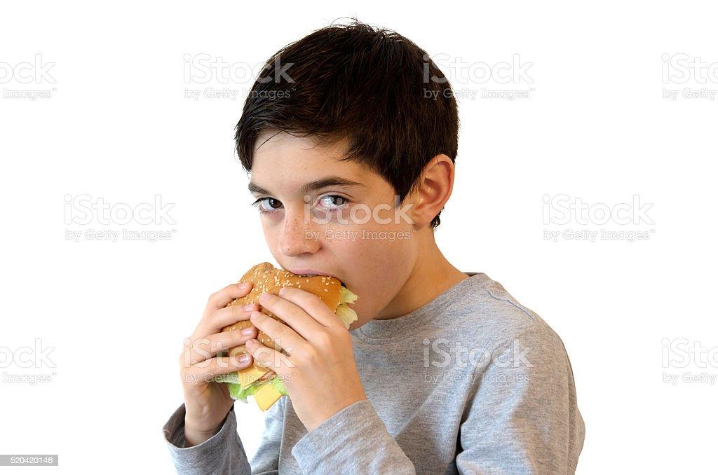 Boy eating a burger royalty-free stock photo
