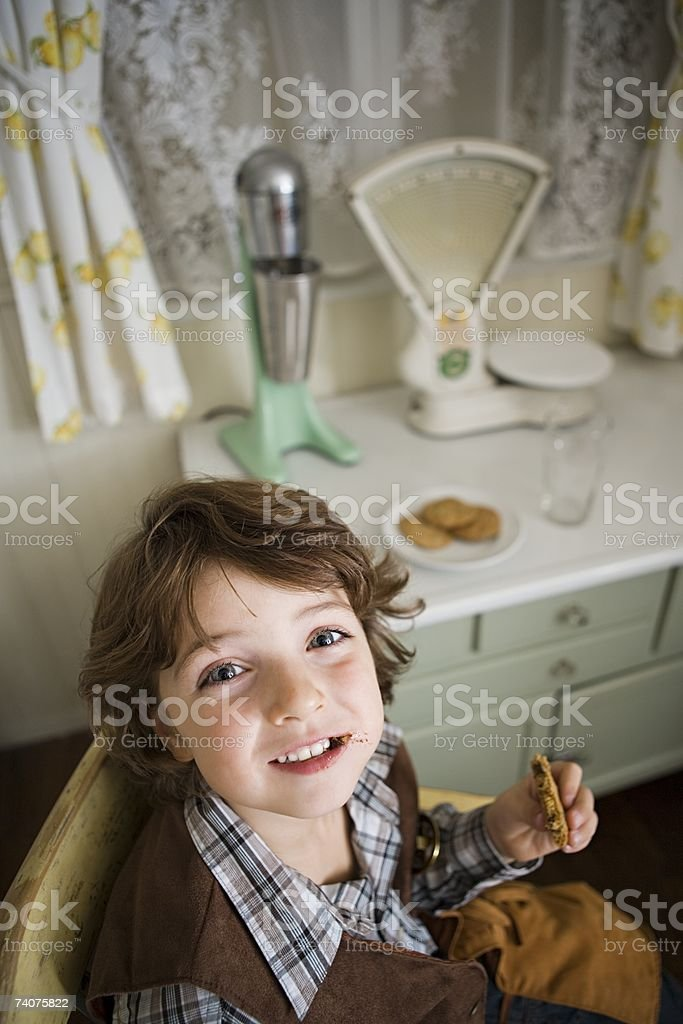 Boy eating cookie royalty-free stock photo