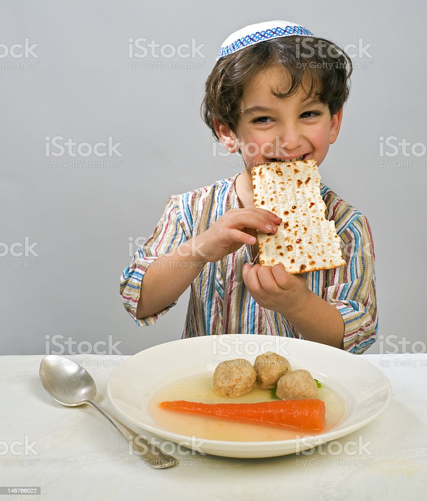 A boy eating his matzo ball soup stock photo