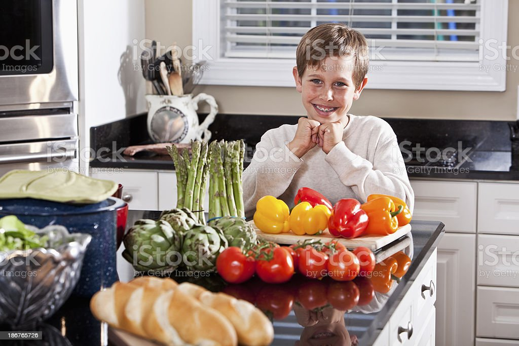 Boy eating right stock photo