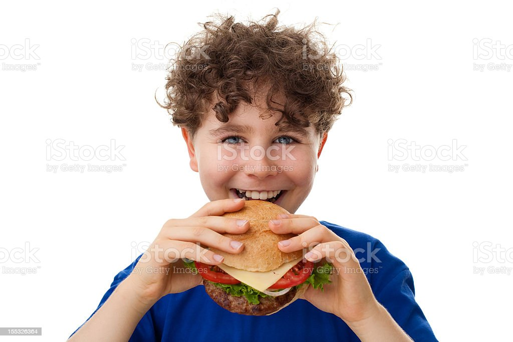 Boy eating sandwich stock photo