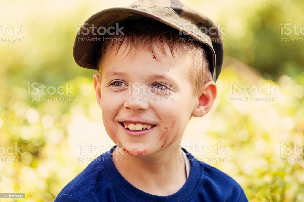 Boy eats berries in the forest stock photo